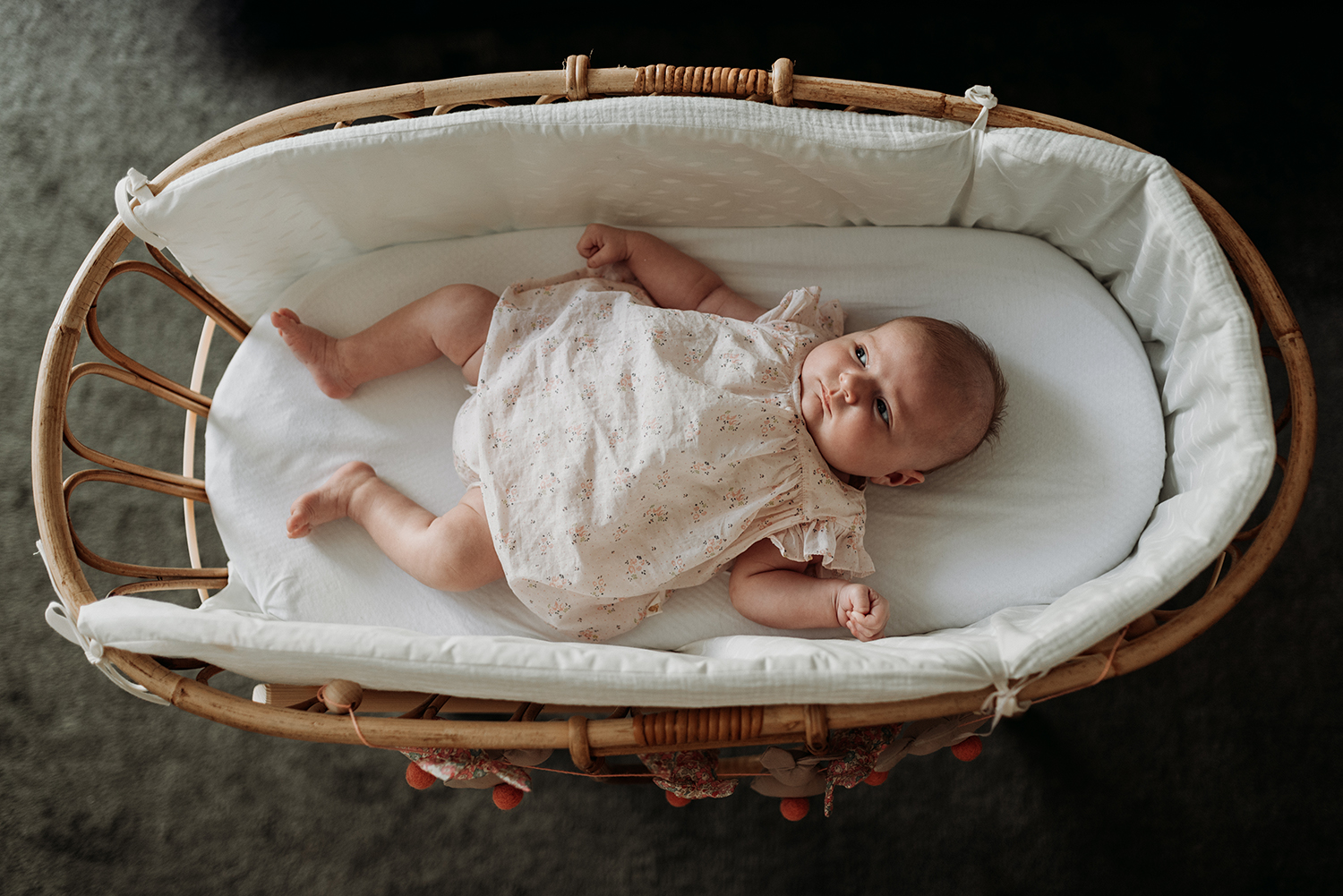 Baby girl in her crib pictured from the top