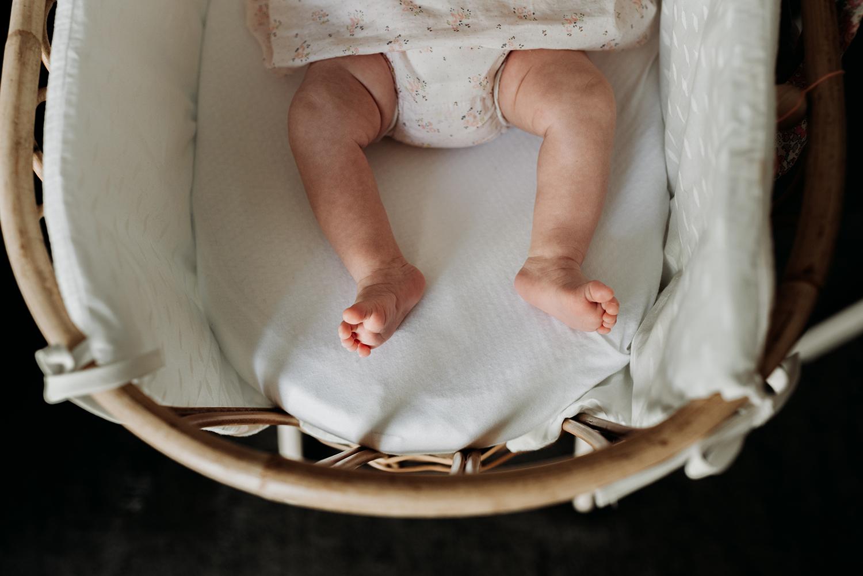 Baby girl feet in her crib