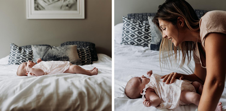 Newborn lying on parents bed