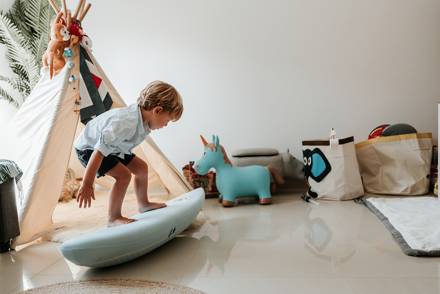 Boy playing with surf board